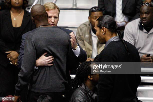 Commissioner Roger Goodell hugs Cincinnati Bengals player Chad Ochocinco during the funeral for Cincinnati Bengals player Chris Henry at the Alario...