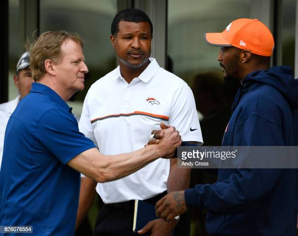 NFL commissioner Roger Goodell left greets Denver Broncos cornerback Aqib Talib at Dove Valley August 03 2017 Former Denver Broncos great and current...