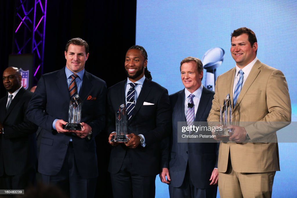 Commissioner Roger Goodell (2ndR) pose with the finalists for the Walter Payton Man of the Year award; Larry Fitzgerald (2ndL) of the Arizona Cardinals, Joe Thomas (R) of the Cleveland Browns and Jason Witten (L) of the Dallas Cowboys during a press conference for Super Bowl XLVII at the Ernest N. Morial Convention Center on February 1, 2013 in New Orleans, Louisiana.