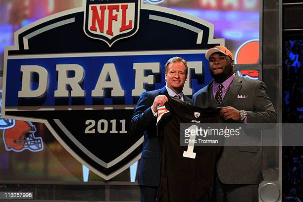 Commissioner Roger Goodell poses for a photo with Phil Taylor #21 overall pick by the Cleveland Browns on stage during the 2011 NFL Draft at Radio...