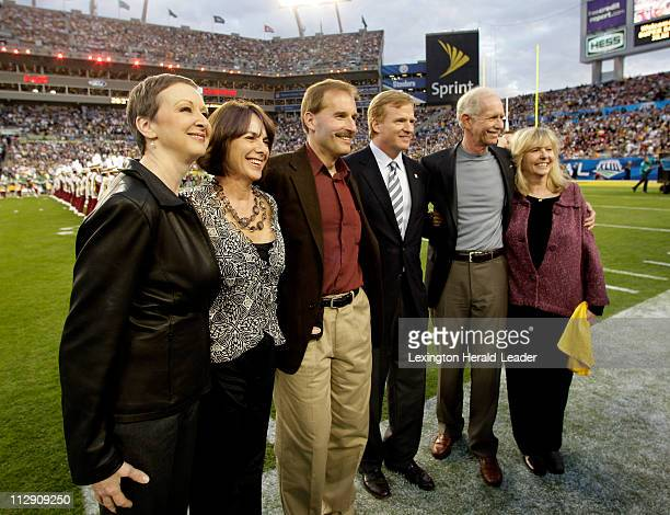 NFL Commissioner Roger Goodell poses with US Airways pilot Chesley B 'Sully' Sullenberger copilot Jeff Skiles and flight attendants Sheila Dail...
