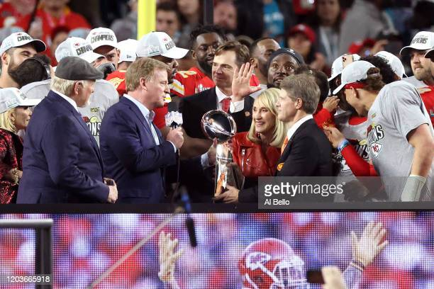 NFL commissioner Roger Goodell presents Kansas City Chiefs owner and CEO Clark Hunt with the Vince Lombardi Trophy after they defeated the San...