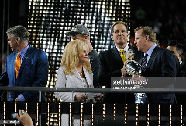 NFL commissioner Roger Goodell presents the Vince Lombardi Trophy to Annabel Bowlen wife of owner Pat Bowlen after defeating the Carolina Panthers...
