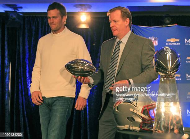 Commissioner Roger Goodell, right, hands New England Patriots quarterback Tom Brady the MVP trophy during the Super Bowl XLIX Winning Team Press...