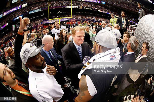 Commissioner Roger Goodell shakes hands with Ray Lewis of the Baltimore Ravens after defeating the San Francisco 49ers during Super Bowl XLVII at the...