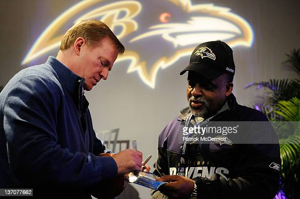 NFL Commissioner Roger Goodell signs his autograph for a fan after a QA prior to the AFC Divisional playoff game between the Houston Texans and the...