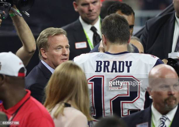 NFL commissioner Roger Goodell speaks to Tom Brady of the New England Patriots after defeating the Atlanta Falcons during Super Bowl 51 at NRG...