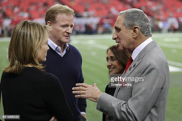 Commissioner Roger Goodell talks with Arthur Blank owner of the Atlanta Falcons prior to the game against the Seattle Seahwaks at the Georgia Dome on...