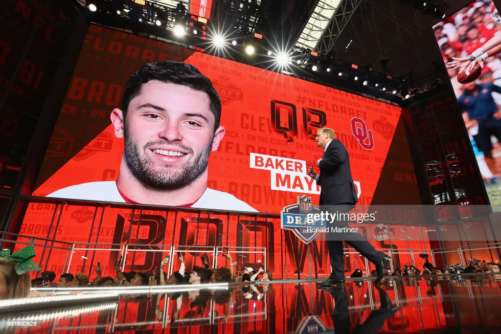 Commissioner Roger Goodell walks past a video board displaying an image of Baker Mayfield of Oklahoma after he was picked #1 overall by the Cleveland Browns during the first round of the 2018 NFL Draft at AT&T Stadium on April 26, 2018 in Arlington, Texas.