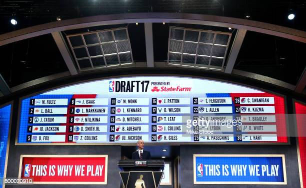 Commissioner speaks as the draft board is seen displaying picks 1 through 30 after the first round of the 2017 NBA Draft at Barclays Center on June...