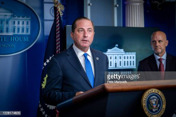 Commissioner Stephen Hahn looks on as Health and Human Services Secretary, Alex Azar, addresses the media during a press conference in James S. Brady...