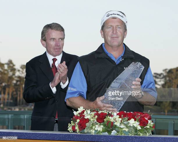 Commissioner Tim Finchem and Fred Funk with the trophy during the final round of THE PLAYERS Championship held at the TPC Stadium Course in Ponte...