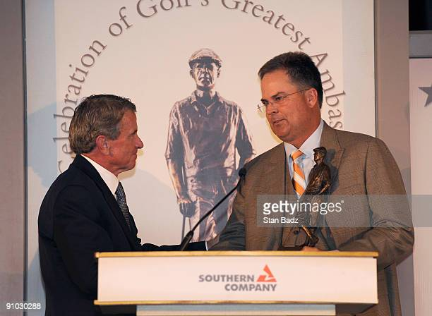 Commissioner Tim Finchem left presents 2009 recipient Kenny Perry right with the Payne Stewart Award who shared Payne Stewart's respect for the...