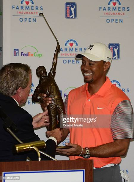 Commissioner Tim Finchem presents Tiger Woods with the Jack Nicklaus Trophy after being named Player of the Year at the Farmers Insurance Open at...