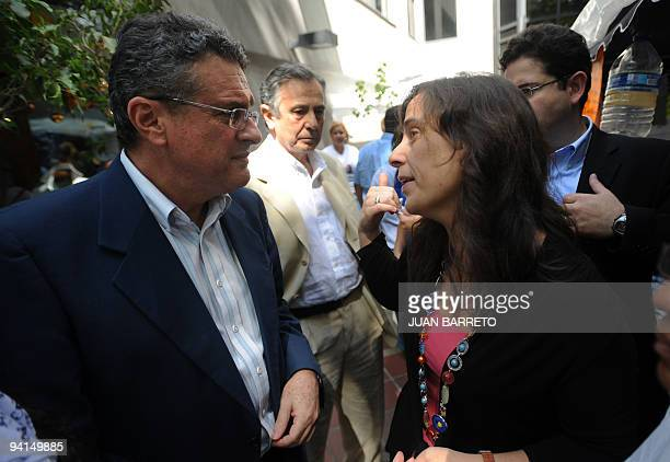 OAS commissioners Rodrigo Zubieta and Antonia Urrejola talk after meeting with Venezuelan students on hunger strike at the organization's...