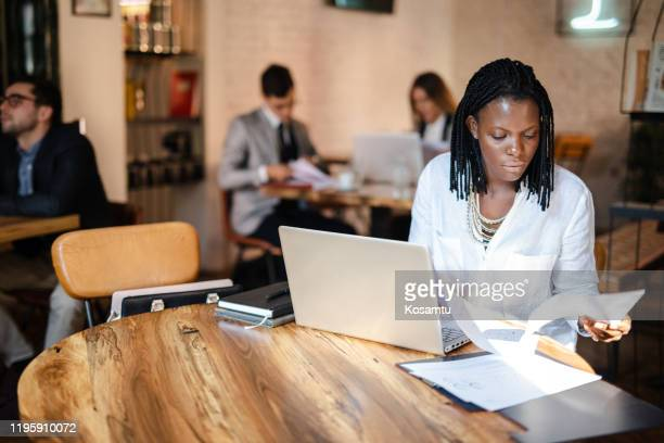 committed female manager for social media marketing working in the coffee shop - social media marketing stock pictures, royalty-free photos & images