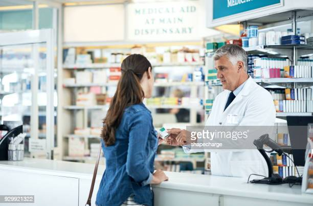 committed to keeping his customers healthy and happy - pharmacy stock pictures, royalty-free photos & images
