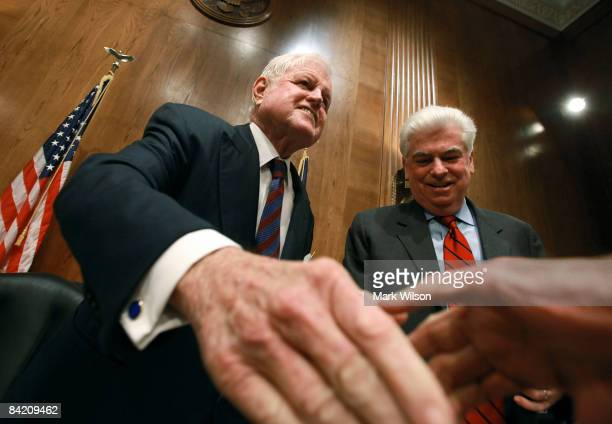 Committee Chairman Edward Kennedy and Sen. Christopher Dodd greet people at the start of a Senate Confirmation hearing for former Senate Majority...