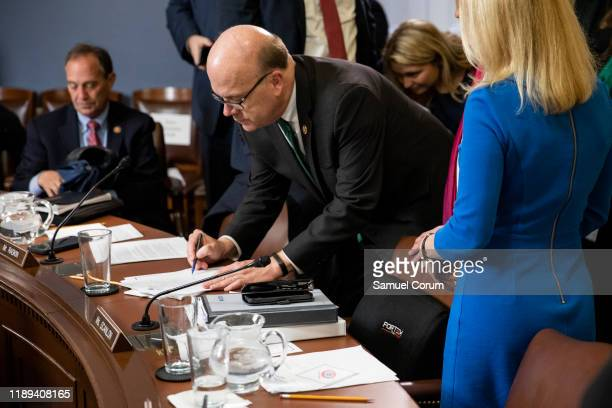 Committee Chairman Jim McGovern signs a notice of the proceedings of the committee for posterity after the conclusion of the House Rules Committee...