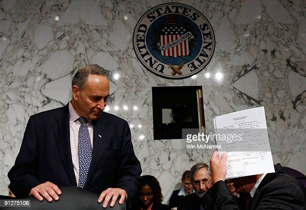 Committee Chairman Max Baucus talks with Sen Chuck Schumer before a markup hearing of the Senate Finance Committee September 30 2009 in Washington DC...