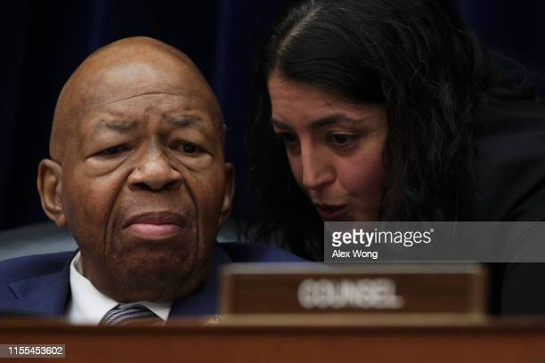 Committee Chairman Rep Elijah Cummings listens to an aide during a meeting of the House Committee on Oversight and Reform June 12 2019 on Capitol...