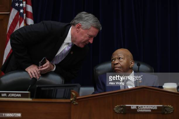 Committee Chairman Rep. Elijah Cummings listens to Rep. Mark Meadows after a meeting of the House Committee on Oversight and Reform June 12, 2019 on...