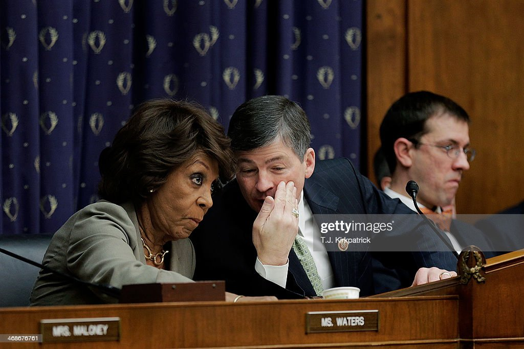Committee Chairman Rep. Jeb Hensarling (R-TX), center, talks with ranking member Rep. Maxine Waters (D-CA) as Janet Yellen, the new Federal Reserve Board chairwoman, testifies before the House Financial Services Committee on February 11, 2014 in Washington, DC. After two weak monthly jobs reports, Yellen's tesitmony is being watched closely for signs of the Fed's intentions to change course from tapering its bond-buying program.
