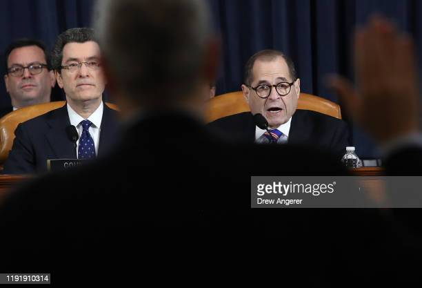 Committee chairman Rep Jerry Nadler swears in constitutional scholars Noah Feldman of Harvard University Pamela Karlan of Stanford University Michael...