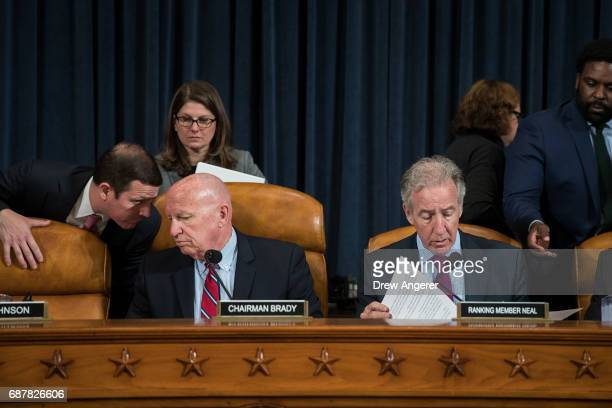 Committee chairman Rep Kevin Brady and ranking member Rep Richard Neal confer with aides before the start of a House Ways and Means Committee hearing...