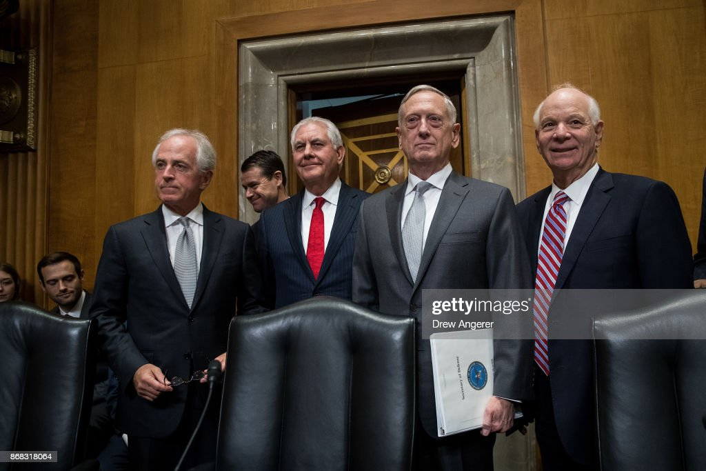 Committee chairman Sen. Bob Corker (R-TN), U.S. Secretary of State Rex Tillerson, U.S. Secretary of Defense James Mattis, and ranking member Sen. Ben Cardin (D-MD) pose for a photo as they arrive for a Senate Foreign Relations Committee hearing concerning the authorizations for use of military force, October 30, 2017 in Washington, DC. As Mattis and Tillerson face questions about the administration's authority to use military force, Congress is still seeking more information about the deadly ambush that killed four U.S. troops in Niger.