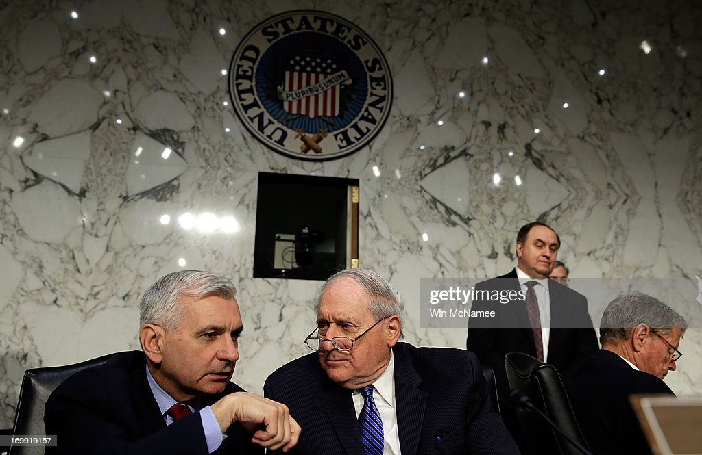 Committee Chairman Sen. Carl Levin (D-MI) (R) confers with Sen. Jack Reed (D-RI) (L) during testimony with U.S. military leaders before the Senate Armed Services Committee on pending legislation regarding sexual assaults in the military June 4, 2013 in Washington, DC. A recent survey of active duty personnel by the Pentagon revealed that 6.1 percent of women and 1.2 percent of men reported receiving Òunwanted sexual contactÓ in the past year.