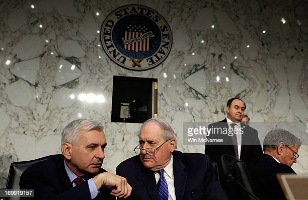 Committee Chairman Sen Carl Levin confers with Sen Jack Reed during testimony with US military leaders before the Senate Armed Services Committee on...
