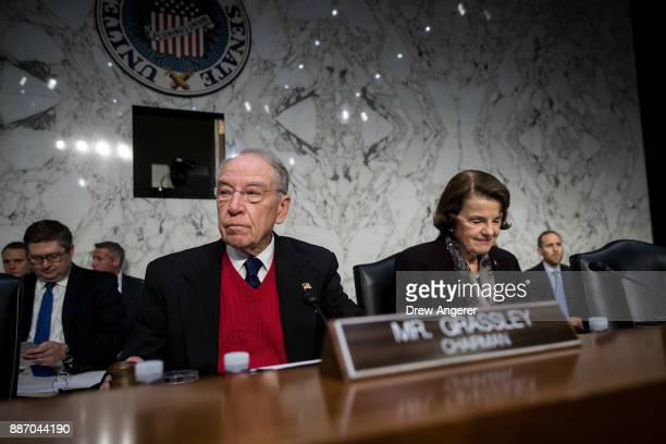 Committee chairman Sen Chuck Grassley and ranking member Sen Dianne Feinstein arrive for a Senate Judiciary Committee hearing concerning firearm...