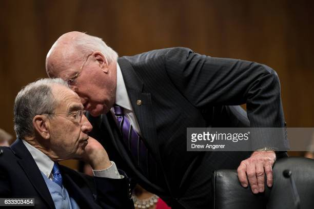 Committee chairman Sen. Chuck Grassley and Sen. Patrick Leahy speak with each other during a meeting of the Senate Judiciary Committee to vote on the...
