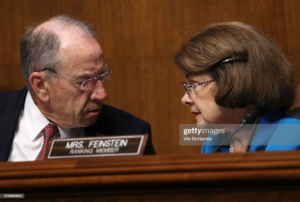 Committee Chairman Sen. Chuck Grassley (L) (R-IA) confers with ranking member Sen. Dianne Feinstein (R) (D-CA) during a Senate Judiciary Committee hearing featuring U.S. Citizenship and Immigration Services Director L. Francis Cissna June 19, 2018 in Washington, DC. The committee heard testimony on recent immigration issues relating to border security and the EB-5 Investor Visa Program.