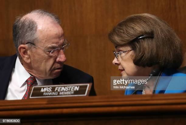Committee Chairman Sen Chuck Grassley confers with ranking member Sen Dianne Feinstein during a Senate Judiciary Committee hearing featuring US...