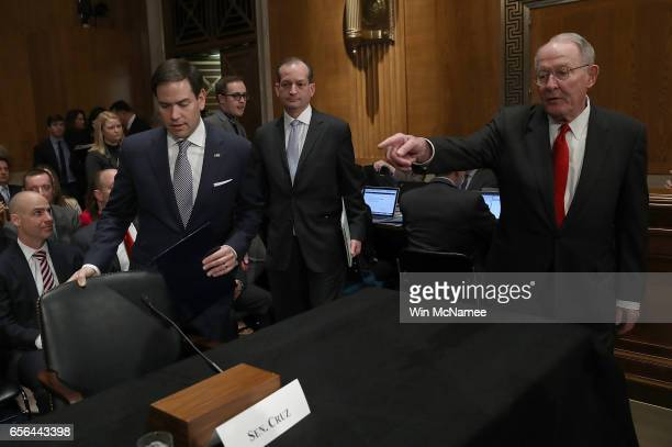 Committee Chairman Sen Lamar Alexander directs Labor Secretary nominee Alexander Acosta to the witness chair while Acosta arrives for testiony before...