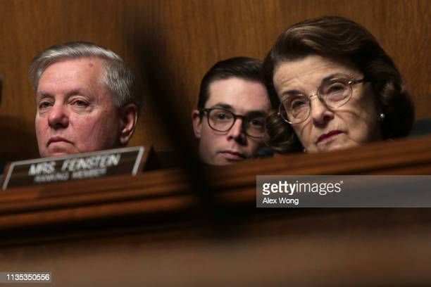 Committee chairman Sen Lindsey Graham and ranking member Sen Dianne Feinstein listen during a hearing before the Senate Judiciary Committee March 12...