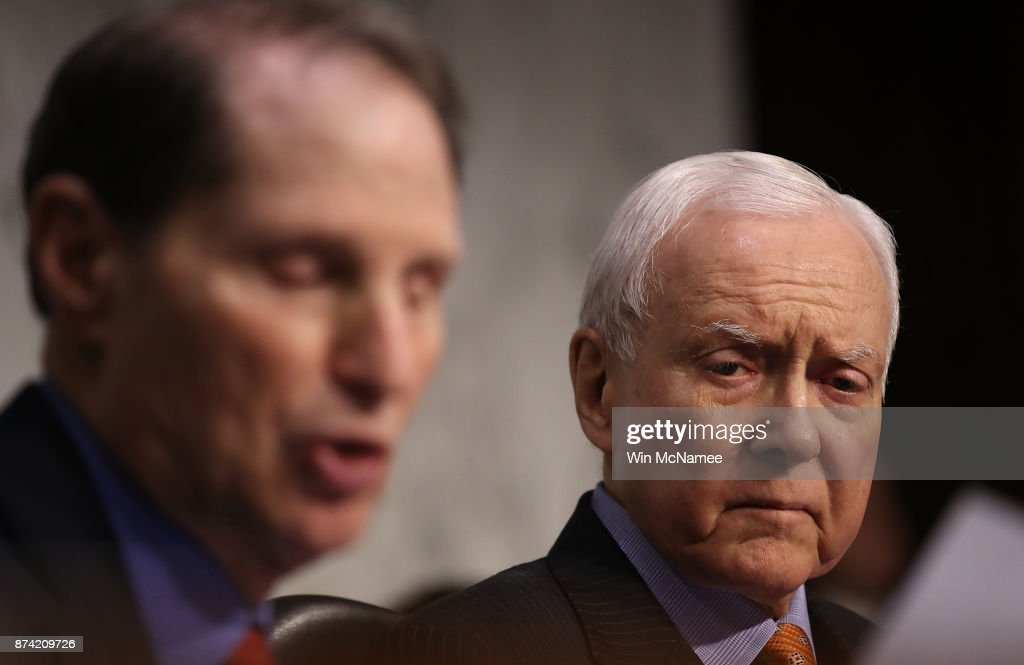 Committee chairman Sen. Orrin Hatch (R) (R-UT) listens as Sen. Ron Wyden, ranking member of the Senate Finance Committee, (L) (D-OR) speaks during a markup of the Republican tax reform proposal November 14, 2017 in Washington, DC. Today, Senate Republicans announced their intention to include a repeal of the mandate for taxpayers to have health insurance in the Affordable Care Act as part of their tax reform proposal.