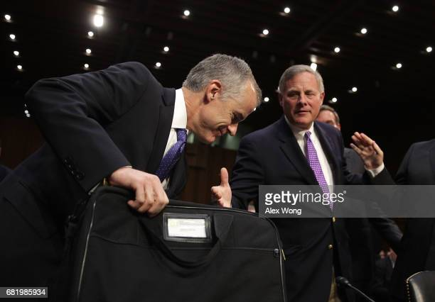 Committee Chairman Sen Richard Burr extends his hand to greet Acting FBI Director Andrew McCabe prior to a hearing before the Senate Intelligence...