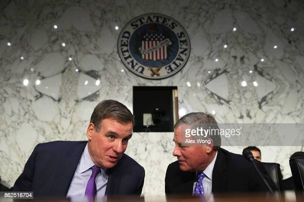 Committee chairman Sen Richard Burr talks to vice chairman Sen Mark Warner during a confirmation hearing for Acting Inspector General of Central...