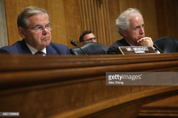 Committee Chairman Sen Robert Menendez and ranking members Sen Bob Corker listen during a hearing before the Senate Foreign Relations Committee June...