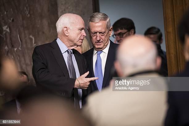 Committee Chairman Senator John McCain speaks with retired Marine Corps General James Mattis as he arrives to testify before the Senate Armed...