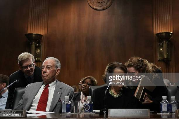 Committee Chairman US Sen Chuck Grassley and ranking member Sen Dianne Feinstein listen to their aides during a markup hearing before the Senate...