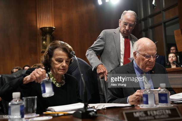 Committee Chairman US Sen Chuck Grassley comes in behind ranking member Sen Dianne Feinstein and Sen Patrick Leahy prior to a markup hearing before...