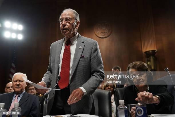 Committee Chairman US Sen Chuck Grassley speaks as ranking member Sen Dianne Feinstein and Sen Orrin Hatch listen during a markup hearing before the...