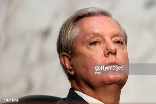 Committee chairman U.S. Sen. Lindsey Graham listens during Supreme Court Justice nominee Judge Amy Coney Barrett's Senate Judiciary Committee...