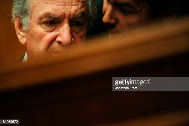 Committee Chairman US Senator Tom Harkin speaks with an aide during the confirmation hearing for Chicago Public Schools CEO Arne Duncan,...