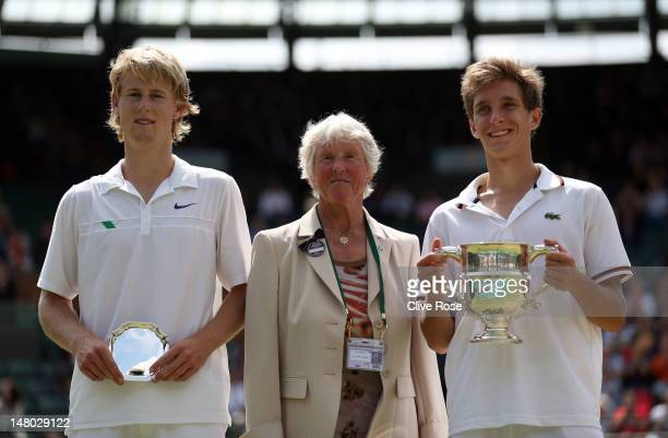 AELTC committee member Ann Jones poses with Runnerup Luke Saville of Australia and winner Filip Peliwo of Canada as they hold up their winners...