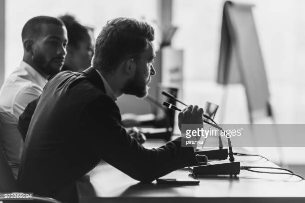 committee member asking or answering questions - press conference stock pictures, royalty-free photos & images